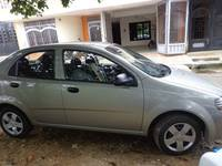 Vendo Aveo Sedan color Beige - Carros - Florencia